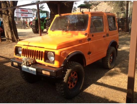 Orange Suzuki 4x4